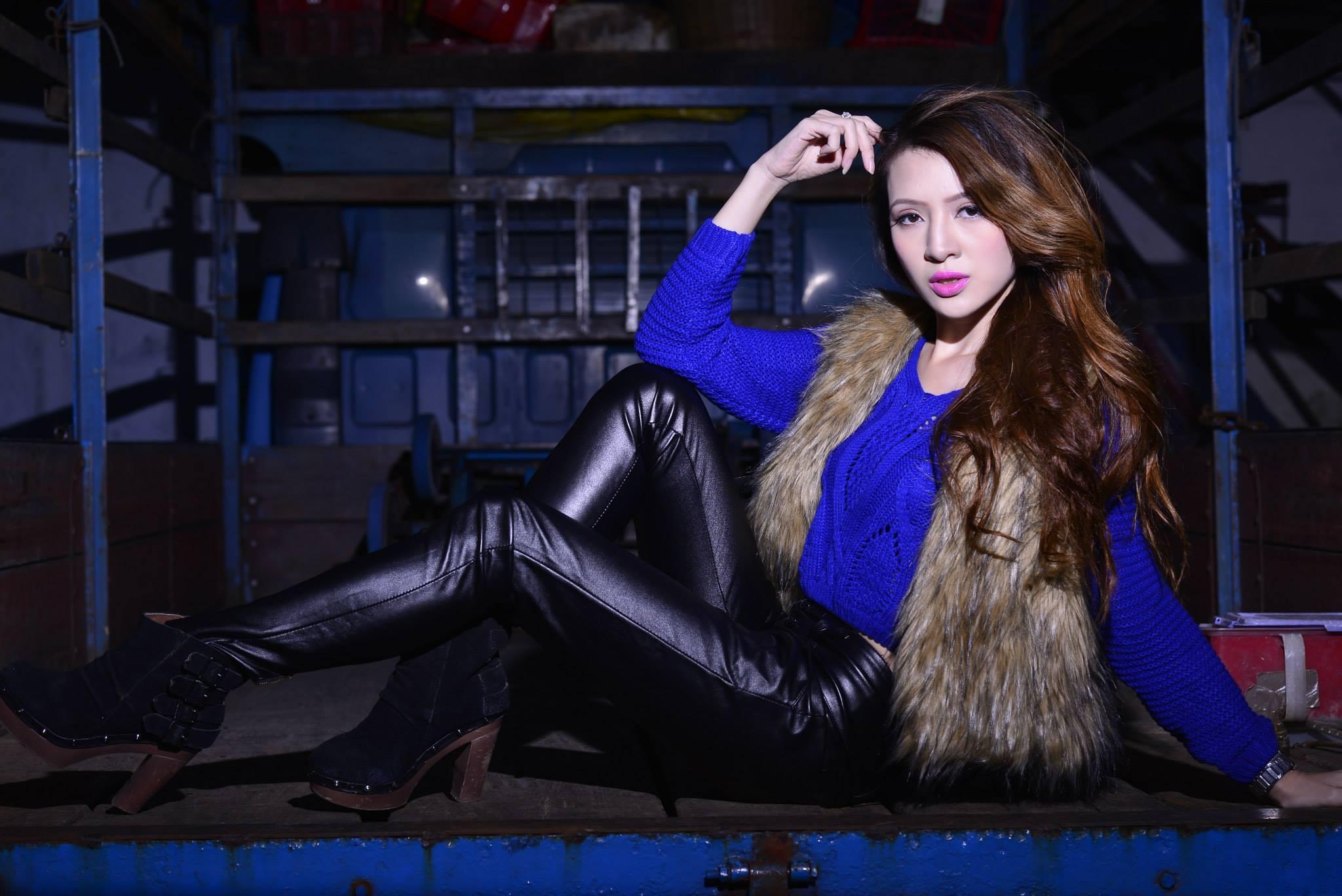 People 2048x1367 brunette Asian women long hair blue sweater leather pants  boots sitting vest