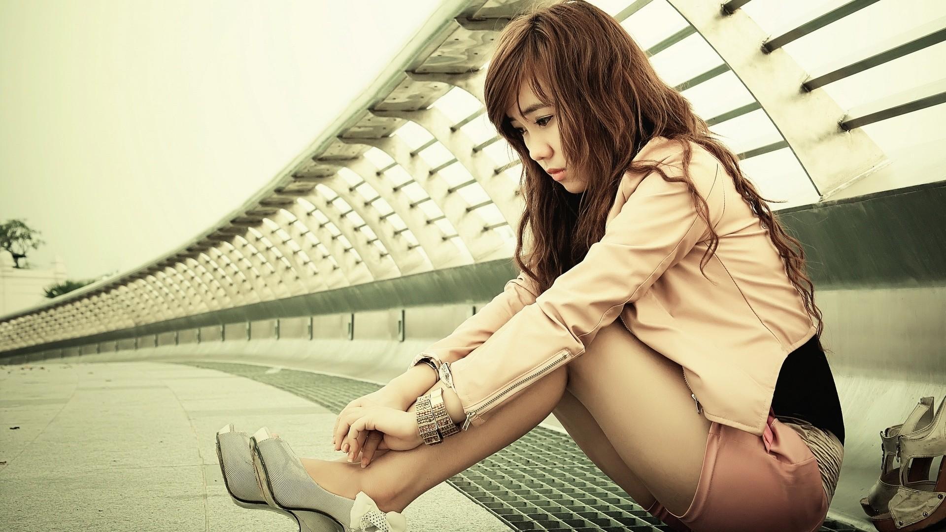 People 1920x1080 women Asian high heels sitting shorts leather jackets brunette bracelets long hair sadness women outdoors