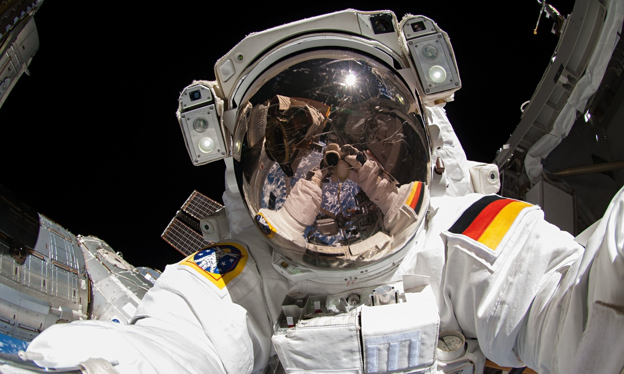 General 2060x1236 space universe space station orbits Orbital Stations space suit German flag helmet self shot camera reflection Earth selfies astronaut International Space Station Alexander Gerst