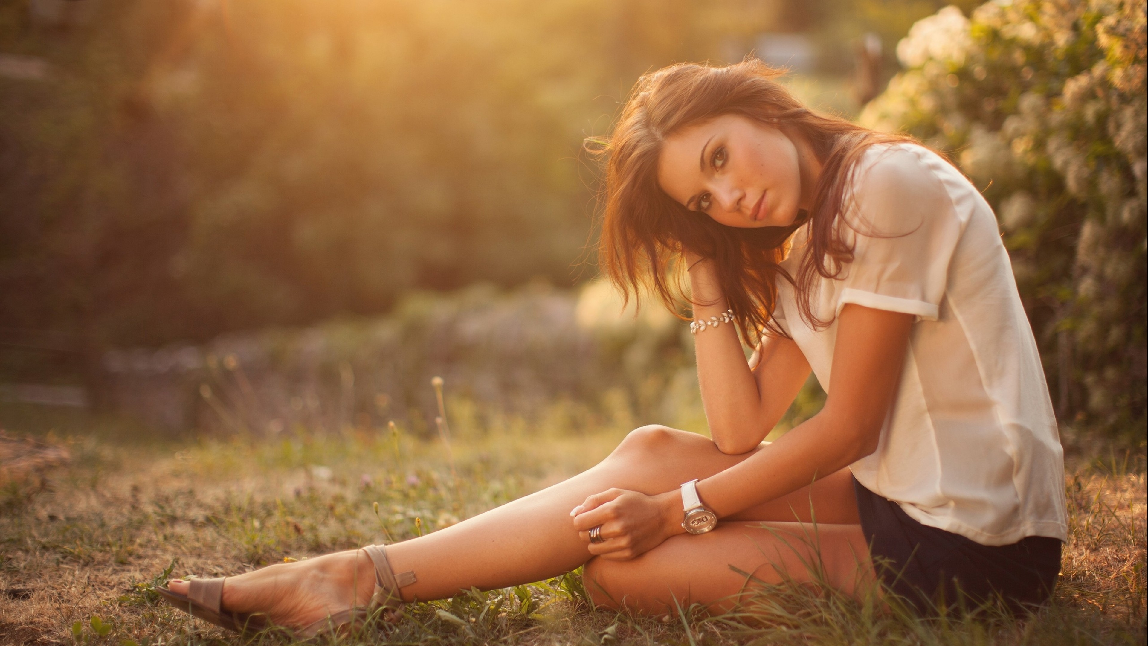 People 3840x2160 women brunette sitting blouses skirt legs women outdoors soft gradient  watches artificial lights plants bokeh photography model looking at viewer