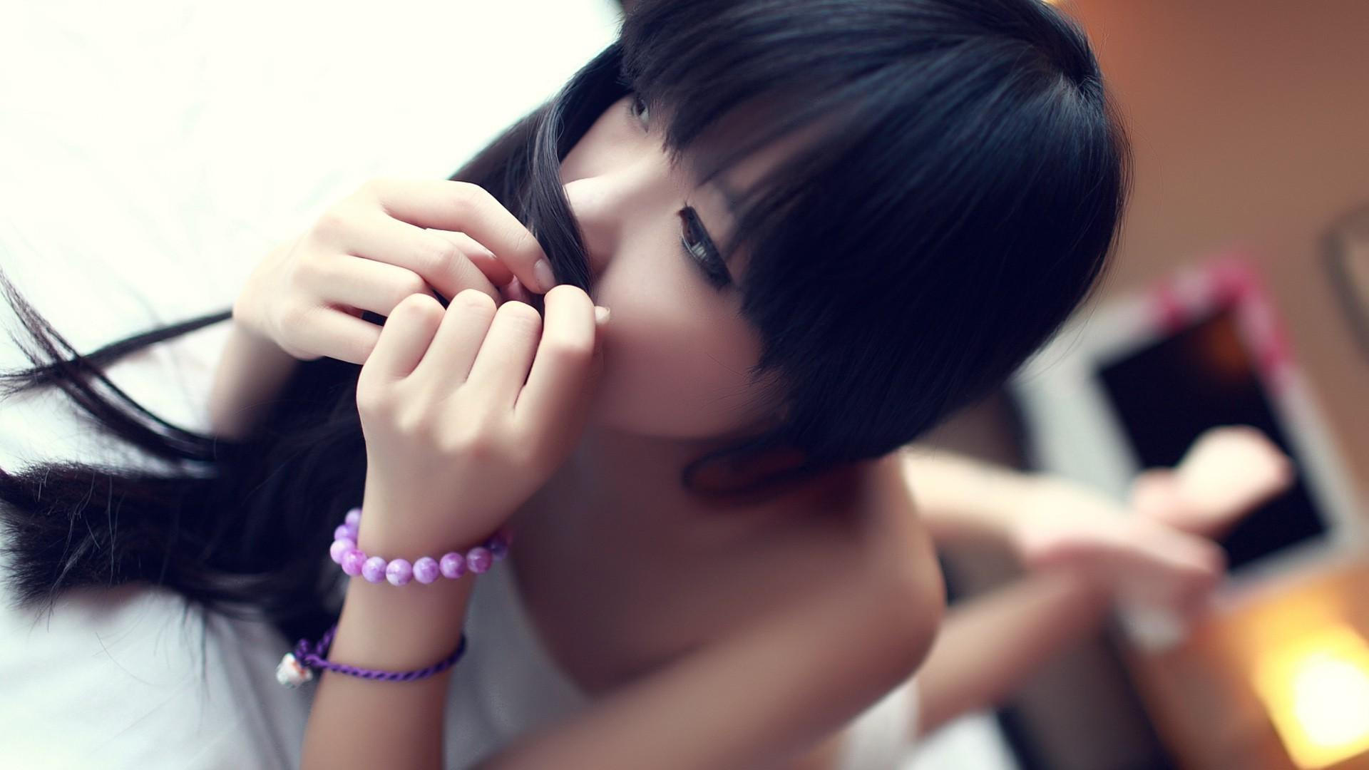 People 1920x1080 Asian women bangs bracelets hands women indoors looking away indoors makeup lying on front dark hair dark eyes model