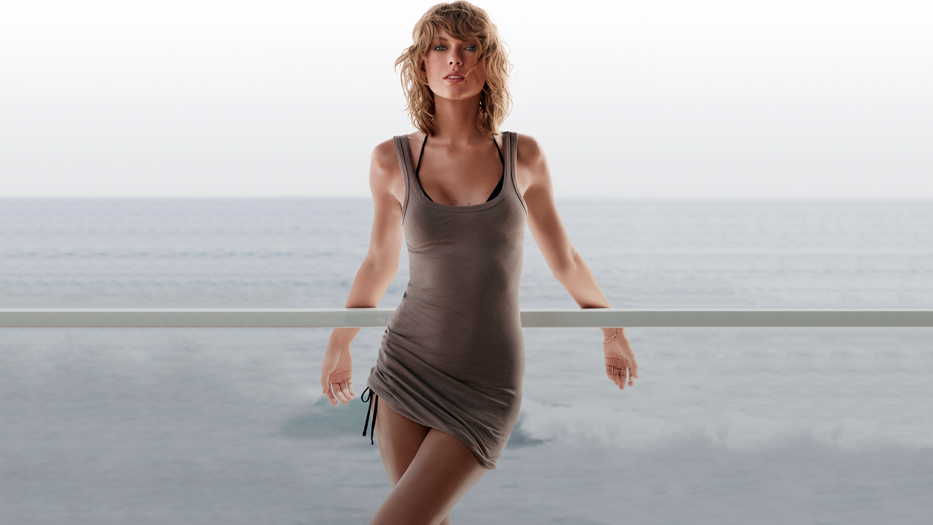 People 1920x1080 women musician Taylor Swift face legs water sea legs crossed horizon waves wavy hair