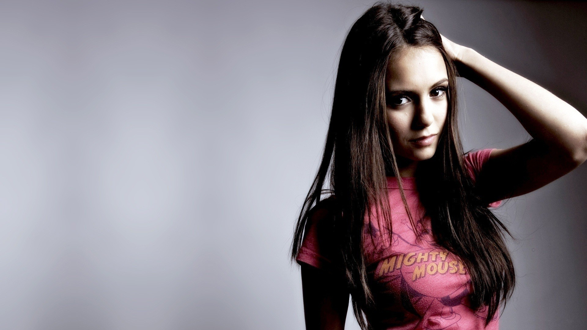People 1920x1080 Nina Dobrev women actress celebrity brunette long hair T-shirt dark eyes eyes simple background pink tops