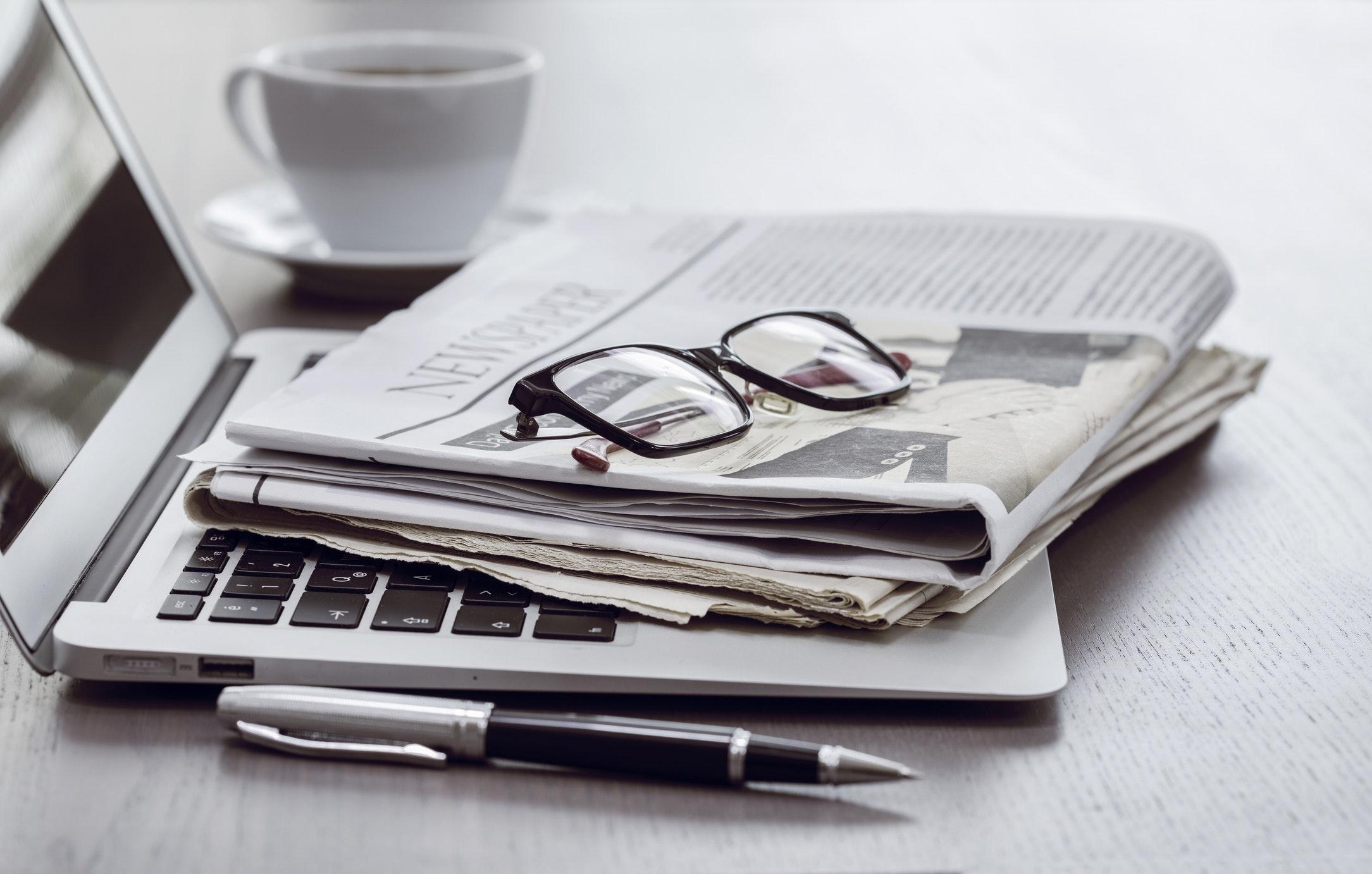 General 2169x1382 newspapers laptop glasses pen