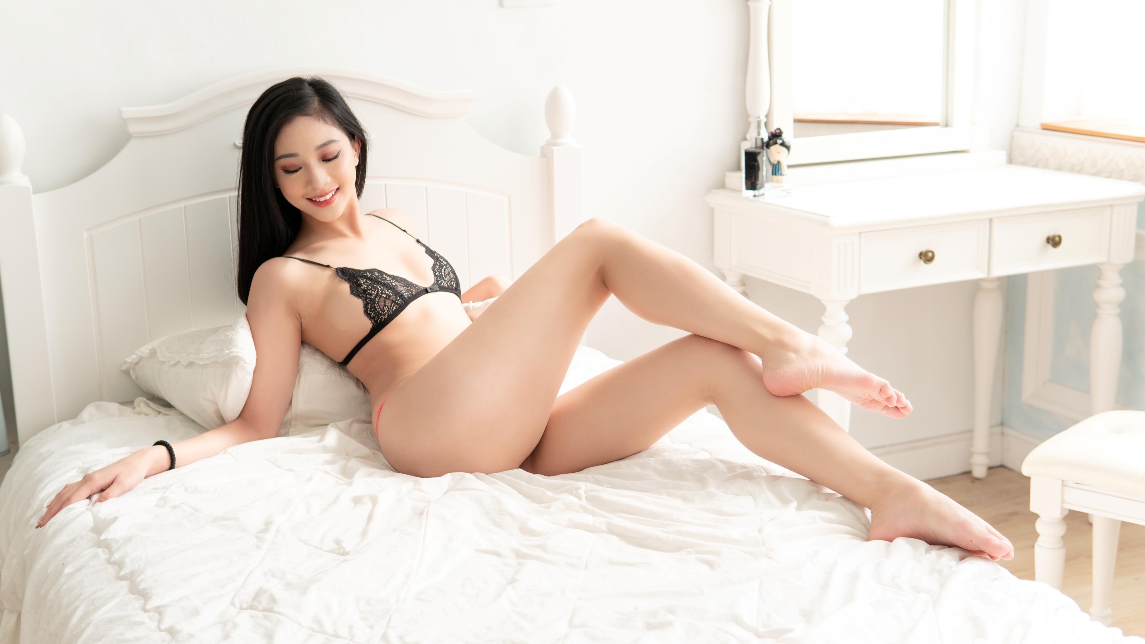 People 3840x2161 Jessie Tsai women model Asian brunette underwear bra G-strings lingerie sitting closed eyes smiling barefoot pointed toes in bed indoors women indoors