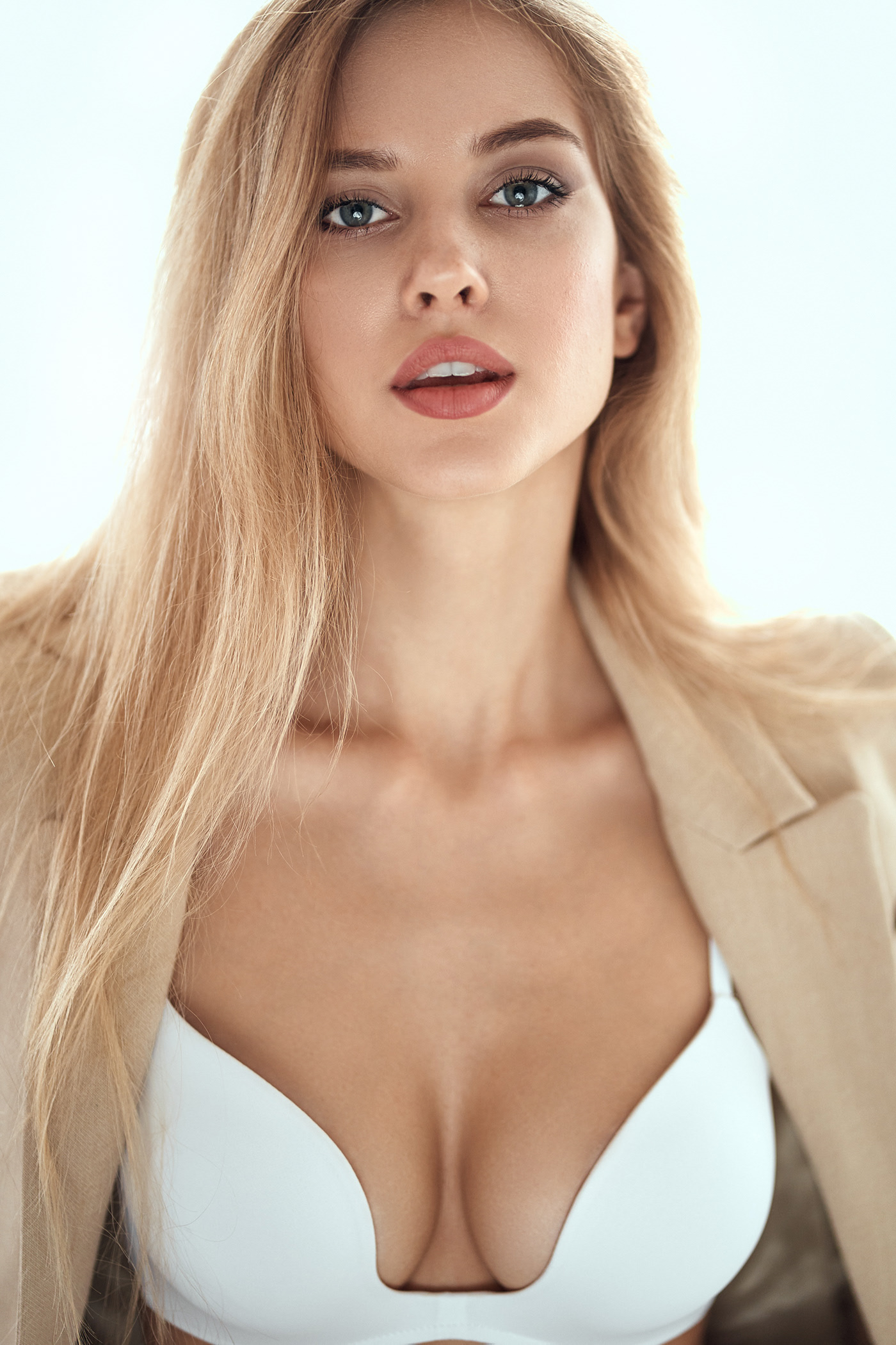 People 1400x2100 Alonso Aydar women blonde long hair suits jacket bra brown clothing makeup lipstick looking at viewer simple background white background Ekaterina Tebekina juicy lips coats portrait open clothes cleavage