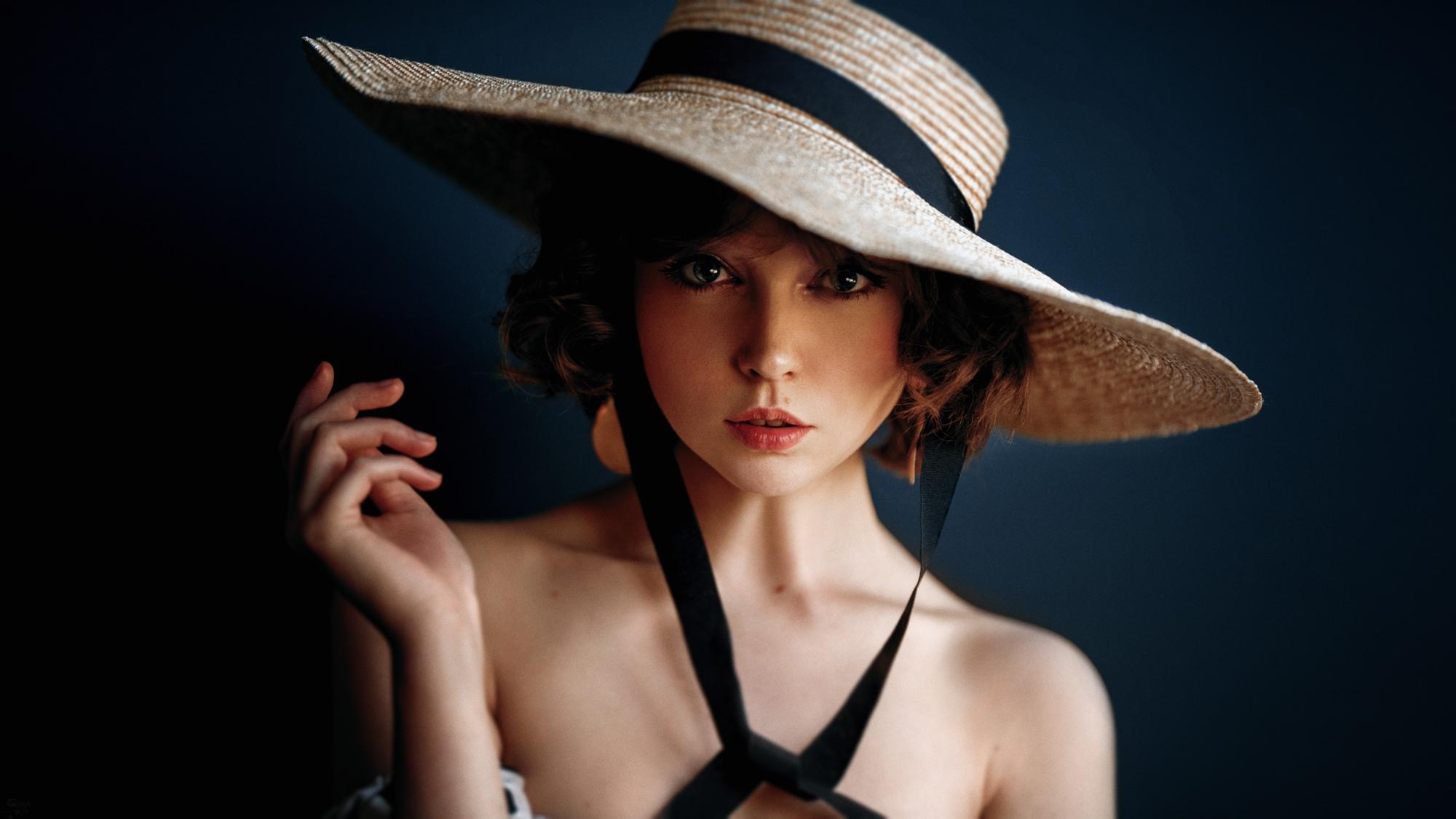 People 2000x1125 Olya Pushkina women model brunette portrait looking at viewer bokeh bare shoulders women with hats hat dark background face Georgy Chernyadyev