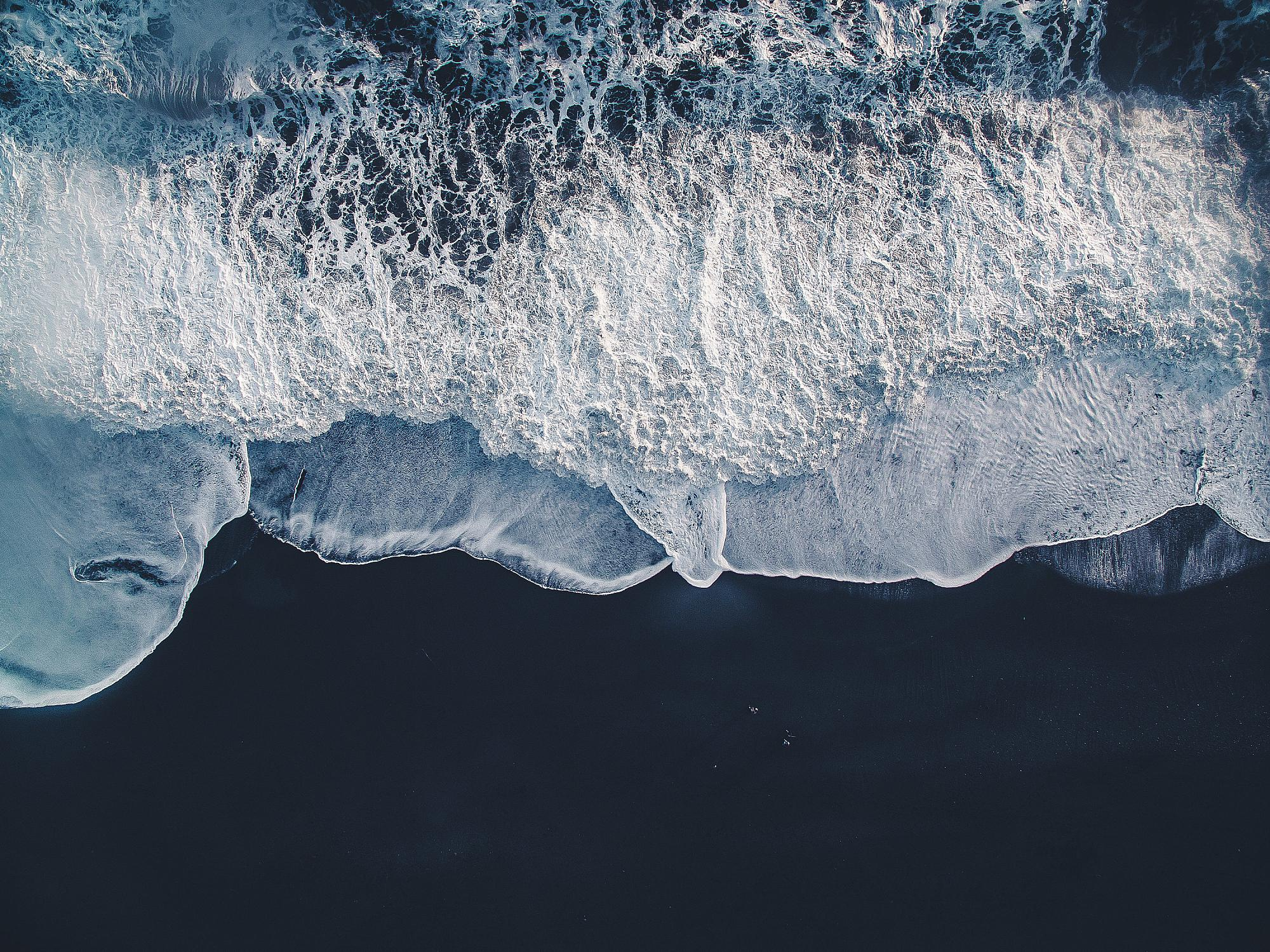 General 2000x1500 aerial view beach outdoors water black sand sea foam bird's eye view