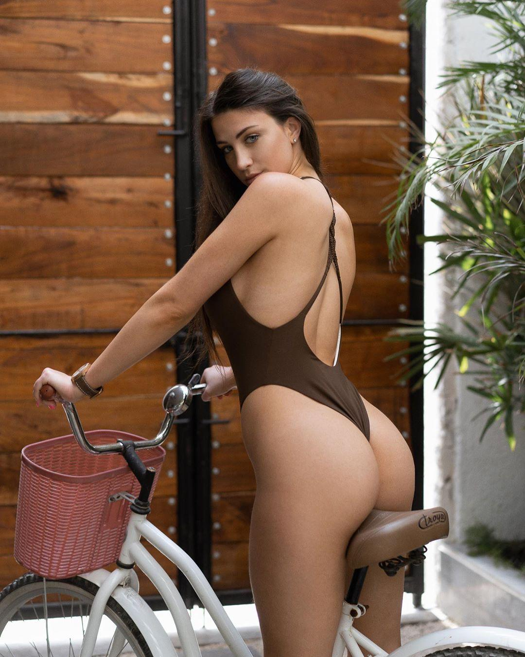 People 1080x1350 jessica bartlett women model brunette one-piece swimsuit ass looking over shoulder bicycle