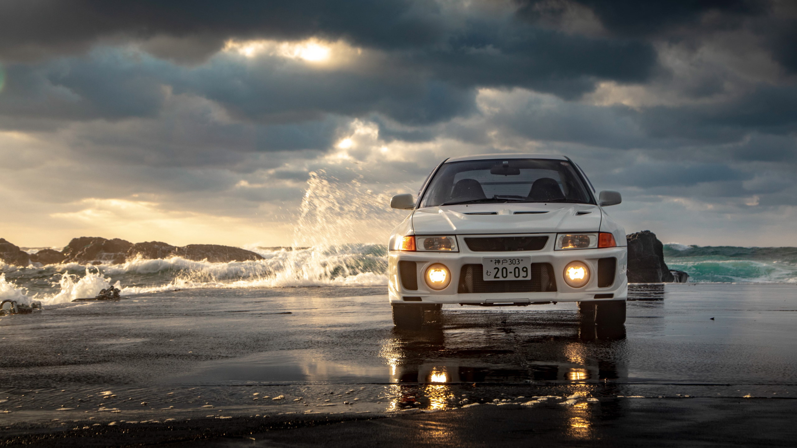General 2560x1440 beach waves Mitsubishi Lancer Evo V Headlights frontal view white cars JDM Japanese cars