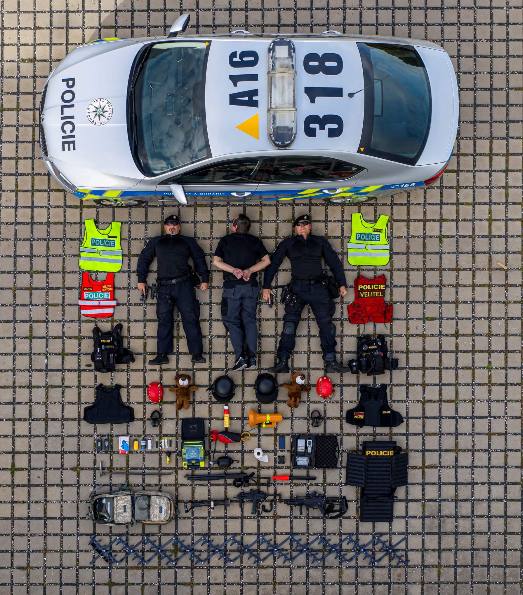 People 1791x2040 photography car police police cars men uniform vest top view bird's eye view tiles Czech Republic czech gun outdoors police men humor vehicle numbers