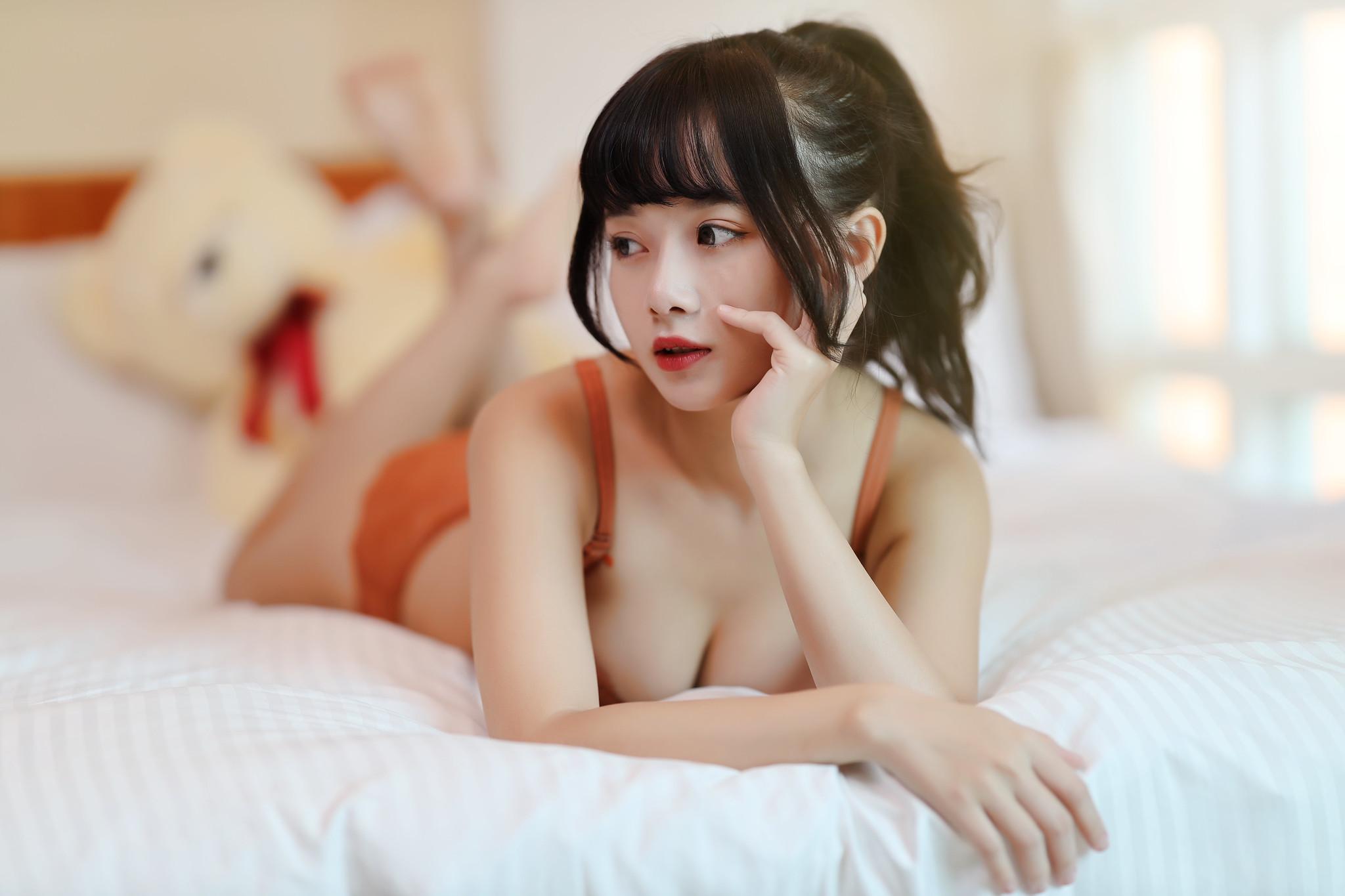 People 2048x1365 Winnie Qian women model Asian looking away bangs ponytail lingerie bra underwear panties lying on front touching face red lipstick in bed bed bokeh portrait indoors women indoors petite