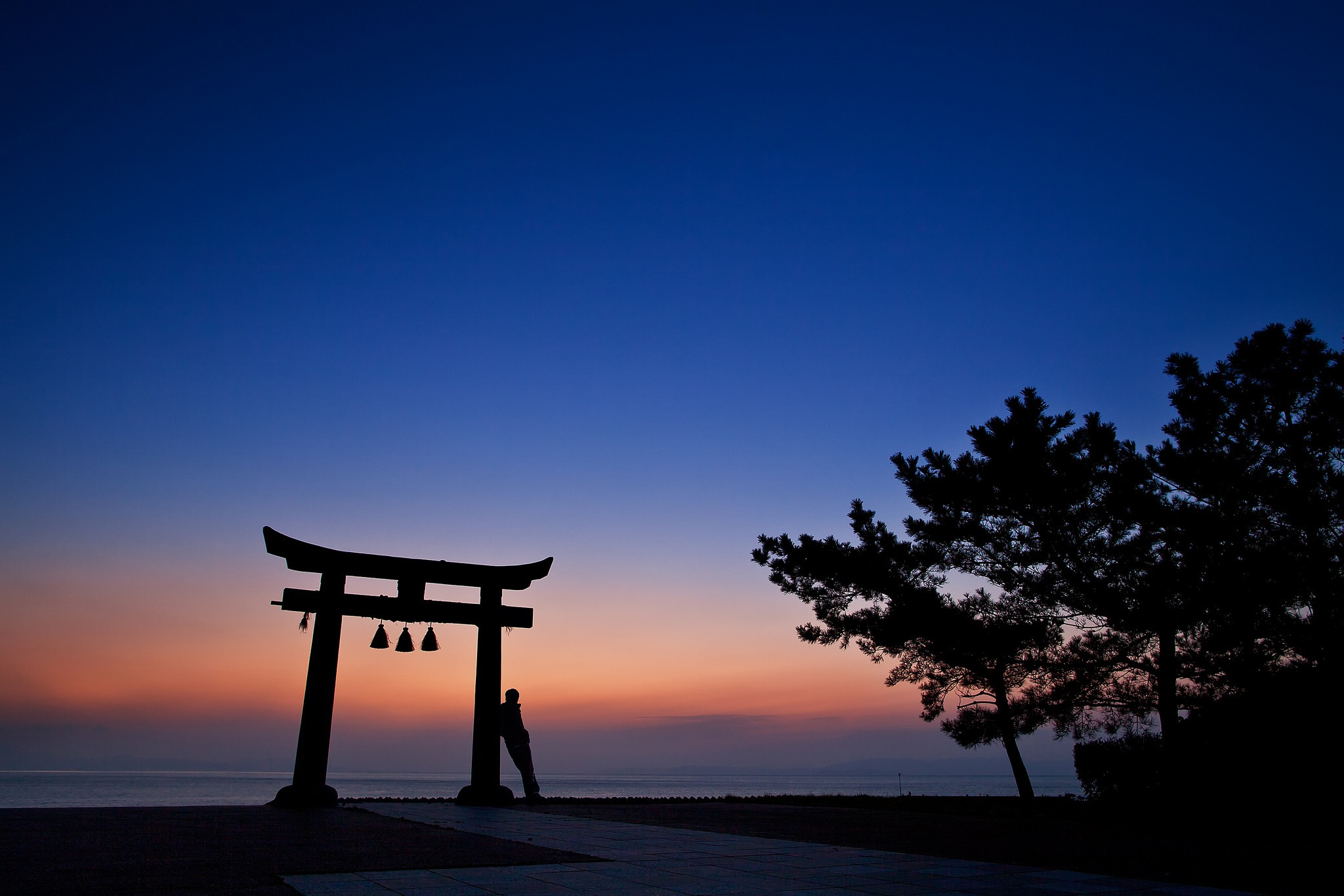 General 2048x1365 nature landscape torii Japan Asia clear sky sunset trees men silhouette sea blue bell calm