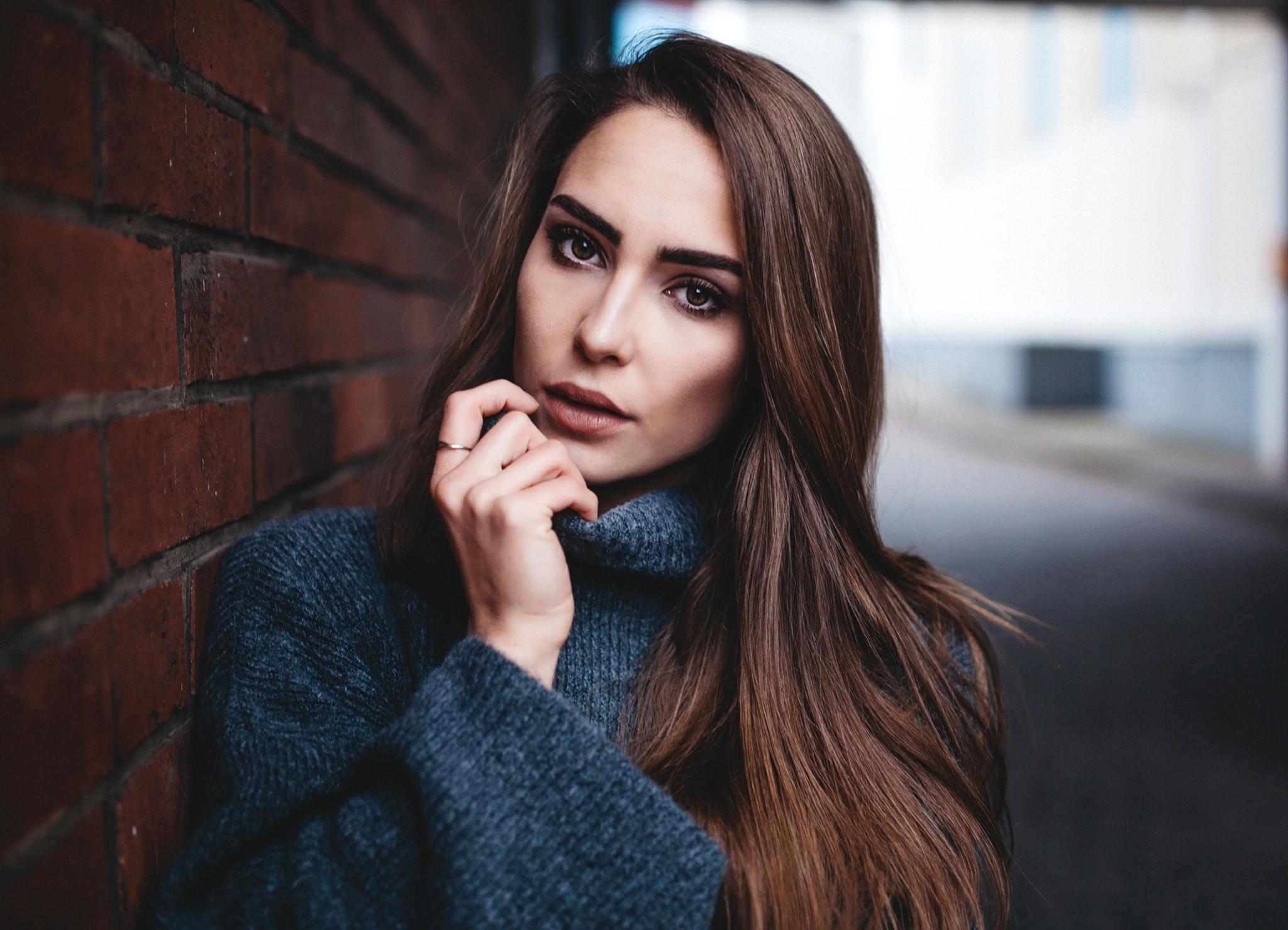People 2048x1479 women face portrait bricks wall depth of field long hair brown eyes straight hair sweater women outdoors blue sweater touching face