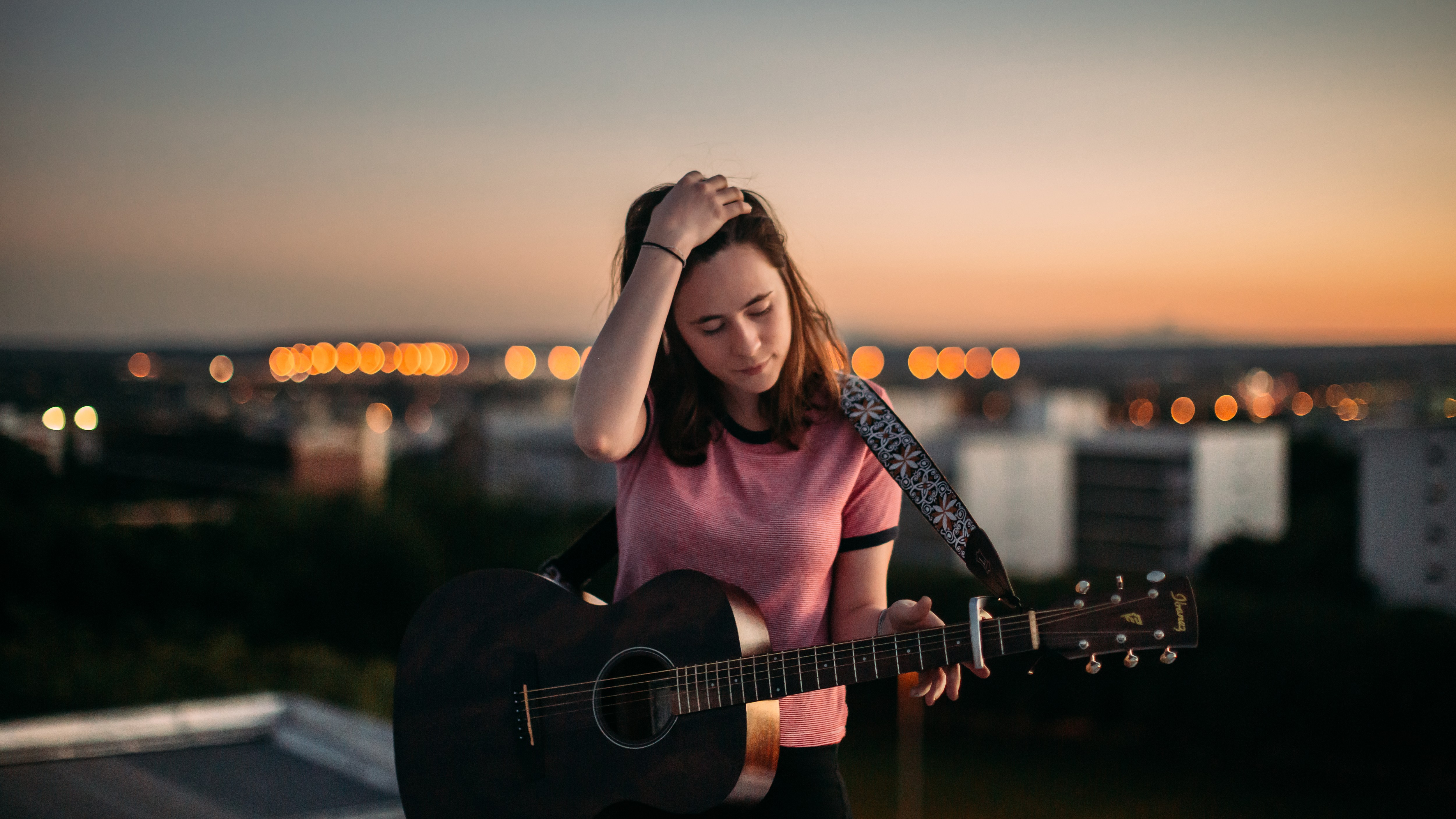 People 5000x2813 women guitarist women outdoors bokeh urban pink tops brunette long hair closed eyes dusk