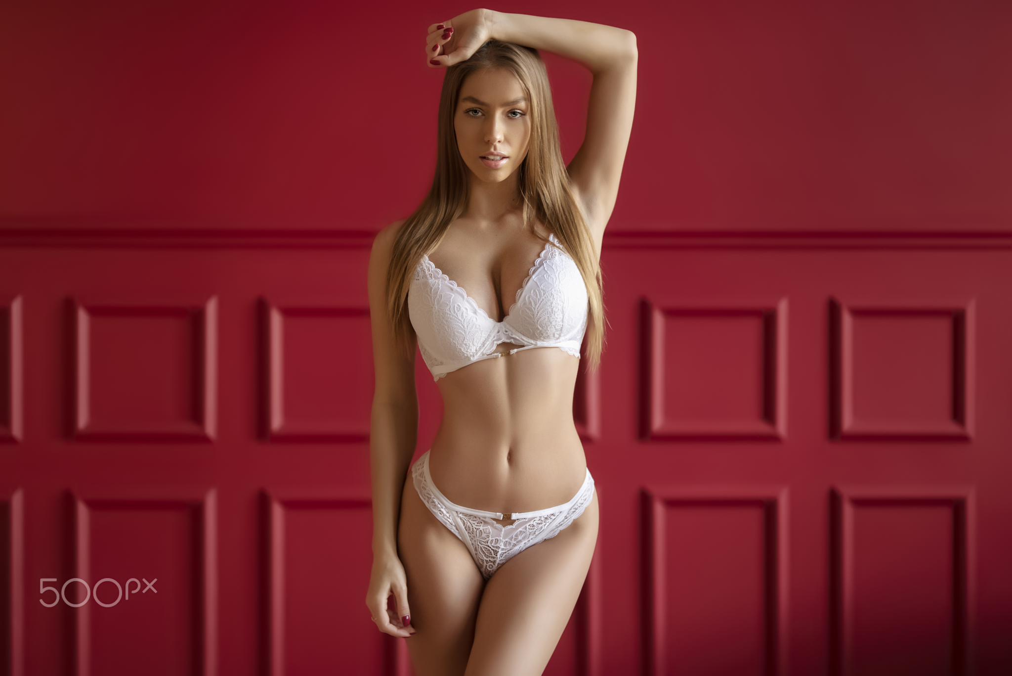 People 2048x1367 Janis Balcuns women blonde long hair straight hair lingerie bra panties hand on head red nails red wall 500px frontal view