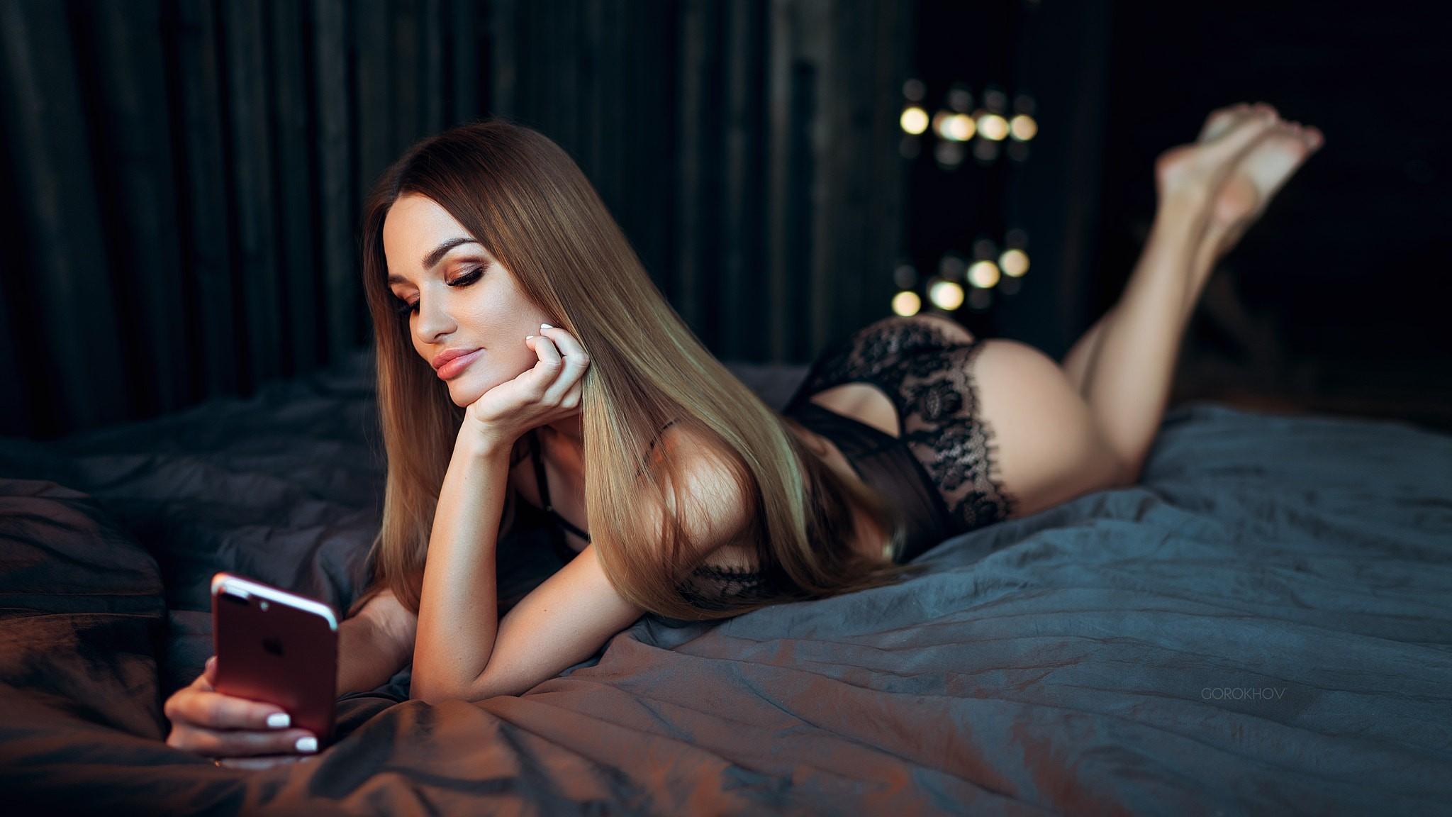 People 2048x1152 women ass cellphone Ivan Gorokhov black lingerie in bed lying on front white nails depth of field brunette straight hair long hair