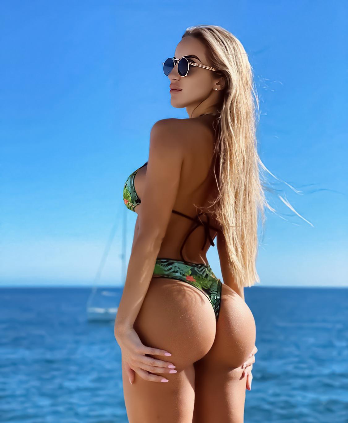 People 1125x1368 Sheila Twin women blonde long hair straight hair sunglasses looking away swimwear bikini ass clear sky water sideboob women with glasses booty scoop
