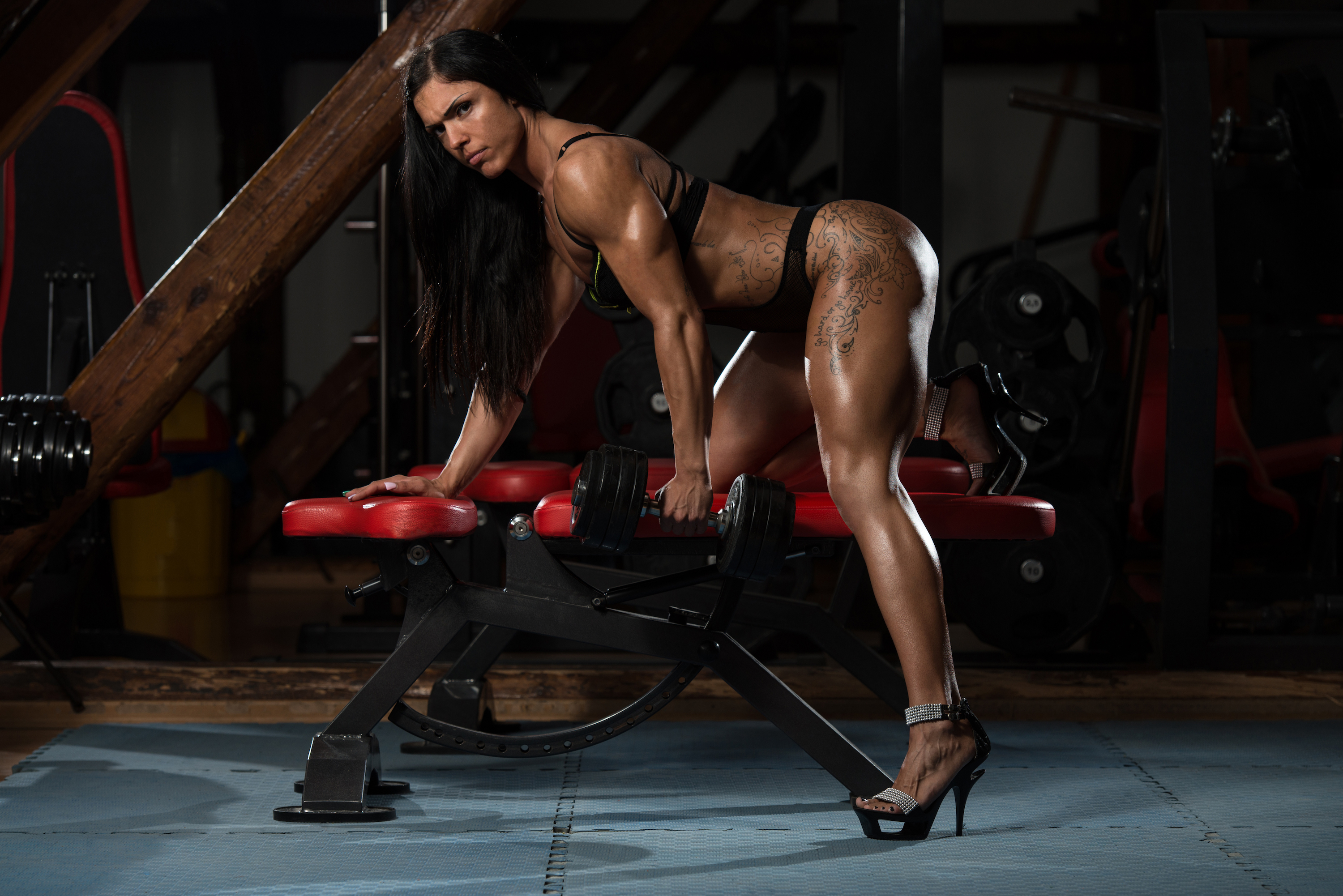 People 3000x2002 women women indoors Bodybuilder Aleksandra Vasiljevic dark hair long hair bodysuit side view looking at viewer weight bench weightlifting high heels glutes tattoo gyms muscular