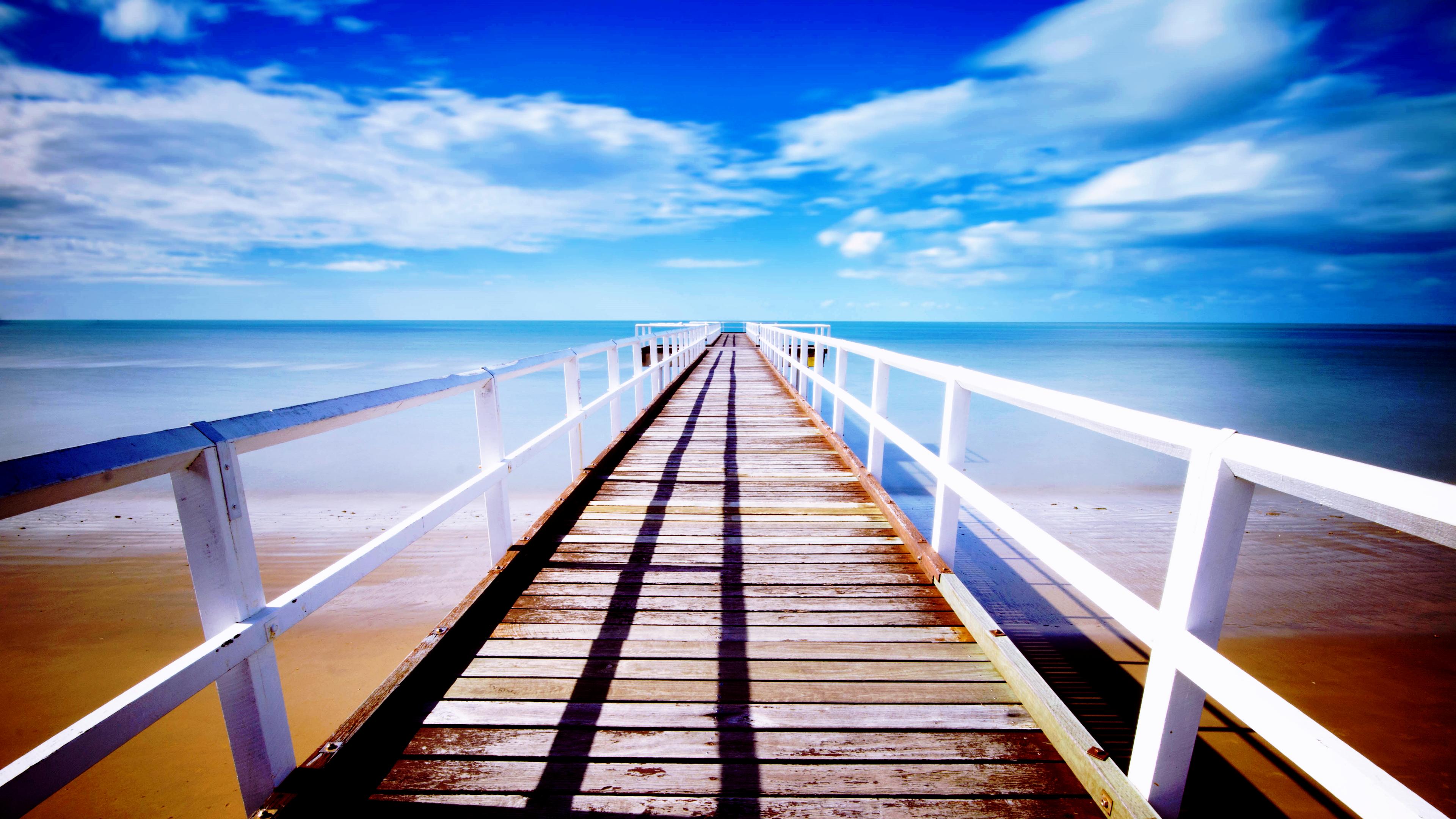 General 3840x2160 bridge pier sky clouds sea water sand blue yellow orange wood white horizon