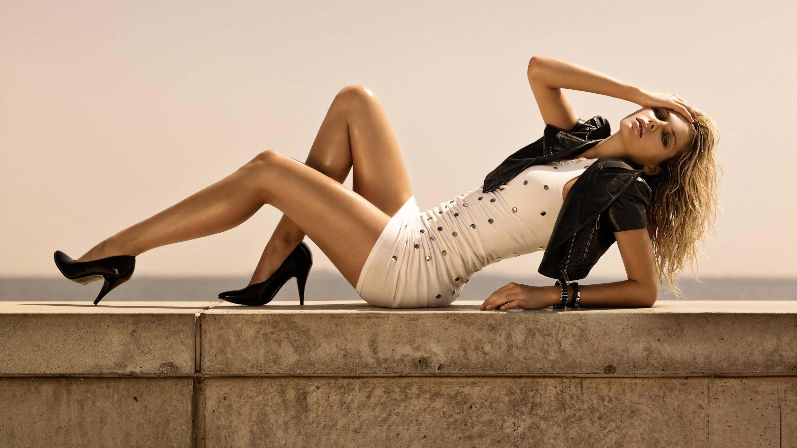 People 2560x1440 women Jessica Hart white dress blonde long hair minidress legs up tanned hand on face